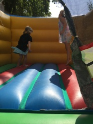 Lucia and Helena testing out the bounce house!